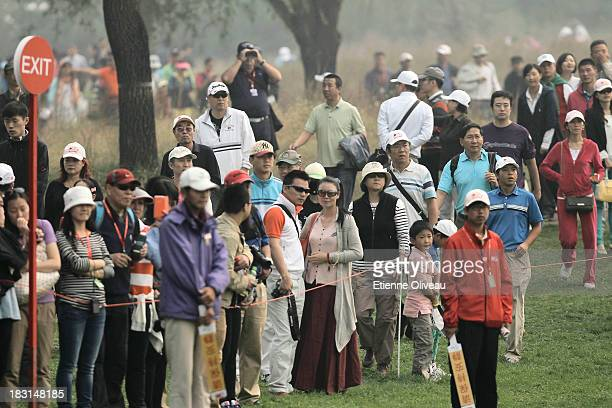 Spectators look on during the third round of the Reignwood LPGA Classic at Pine Valley Golf Club on October 5 2013 in Beijing China