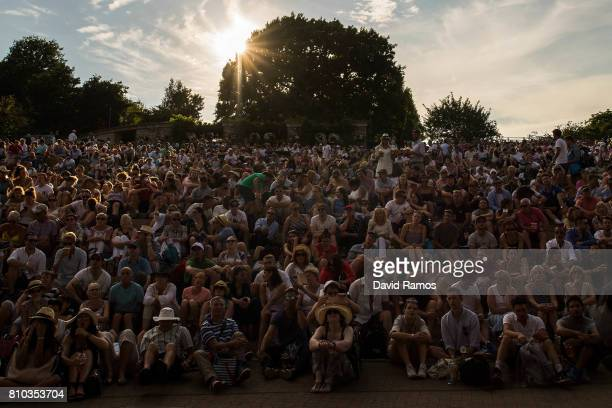 Spectators look on from 'Murray Mound' on day five of the Wimbledon Lawn Tennis Championships at the All England Lawn Tennis and Croquet Club on July...