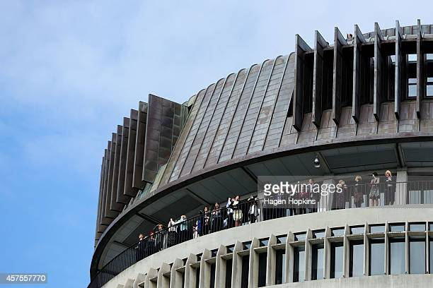 Spectators look on from the Beehive during the 51st Parliament's State Opening Ceremony at Parliament on October 21 2014 in Wellington New Zealand...