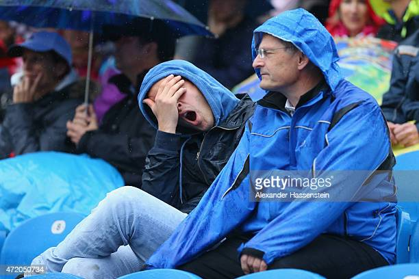 Spectators look on from the centre court during a rain delay prior to the BMW Open final between Andy Murray of Great Britain and Philipp...