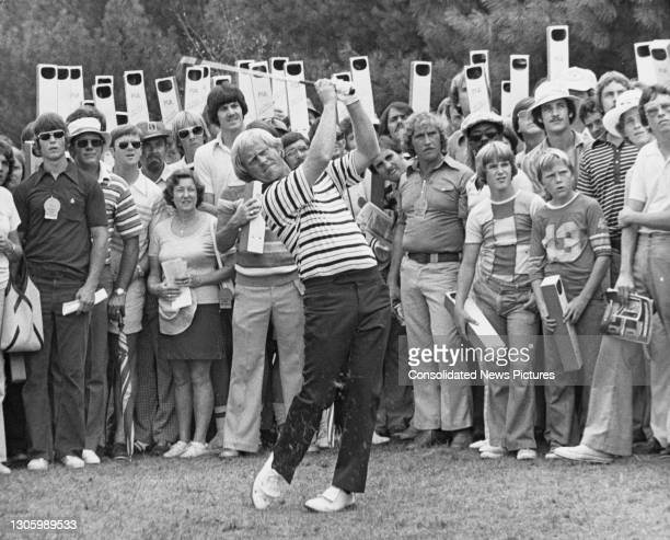 Spectators look on using periscopes to view as Jack Nicklaus of the United States plays an approach shot to the 3rd green during the 58th PGA...