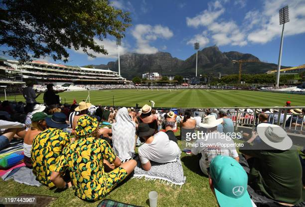 Spectators look on with a view of Table Mountain during Day Two of the Second Test between England and South Africa on January 04 2020 in Cape Town...