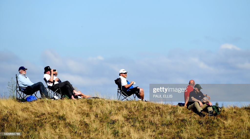 Spectators look over the 15th green on the first day of the 2018 Women's British Open Golf Championships at Royal Lytham & St. Annes Golf Club, northwest England, on August 2, 2018.