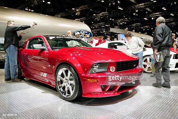 Spectators look over the 2005 Saleen S281 Ford Mustang at the Chicago Auto Show on February 11 2005 in Chicago Illinois The Auto Show opened to the...