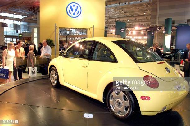 Spectators look over the new Volkswagon Beetle which is making its first appearance in Australia at the Sydney Motor Show 15 October The Beetle will...