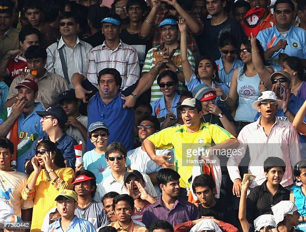 Spectators make 'monkey' impressions as Andrew Symonds of Australia comes in to bat during the seventh one day international match between India and...