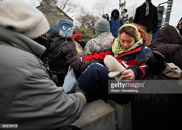 Spectators make their way over cement barricades after the inauguration of Barack Obama as the 44th president of the United States of America on the...