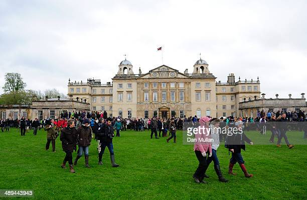 Spectators make their way past Badminton House on day five of the Badminton Horse Trials on May 11 2014 in Badminton England