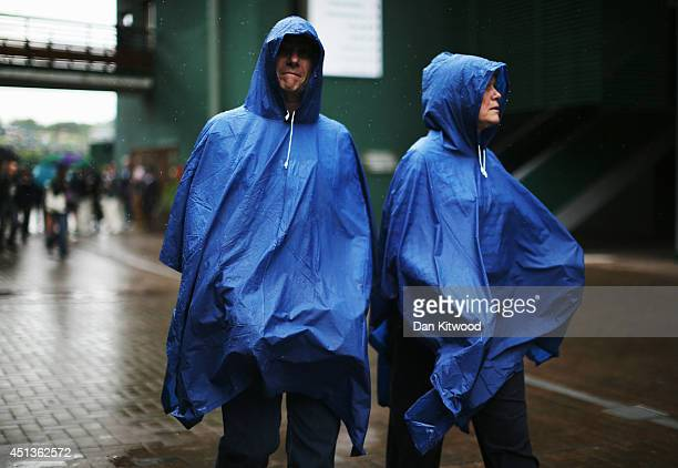Spectators make their way to the courts on day six of the Wimbledon Lawn Tennis Championships at the All England Lawn Tennis and Croquet Club at...