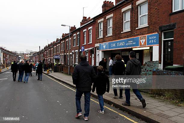 Spectators make their way to the stadium prior to the FA Cup with Budweiser Third Round match between Luton Town and Wolverhampton Wanderers at...