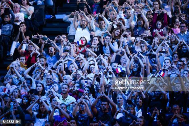 Spectators making Paris 2024 signs during the FIG World Cup Challenge Internationaux de France at AccorHotels Arena on September 17 2017 in Paris...