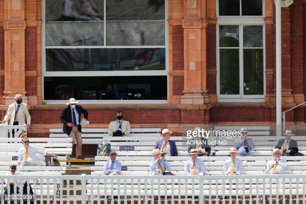 Spectators observe social distancing rules on the first day of the first Test cricket match between England and New Zealand at Lord's Cricket Ground...
