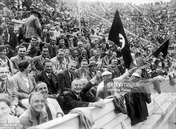 Spectators Of The WaterPolo Match Pitting The French Men'S Team Against That Of Germany'S On August 8 1936 In Berlin German Fans Waved The Flag With...