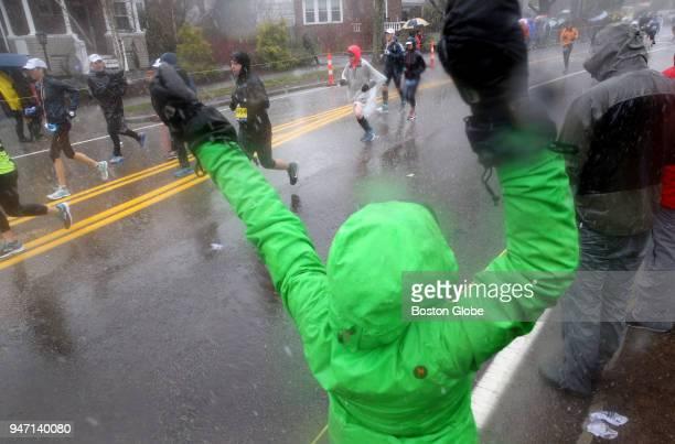 Spectators offer encouragement on Heartbreak Hill during the Boston Marathon in Newton Mass April 16 2018
