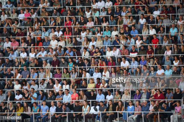 spectators on a stadium - audience stock pictures, royalty-free photos & images