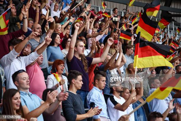 spectators on a stadium with german flags - world championship stock pictures, royalty-free photos & images