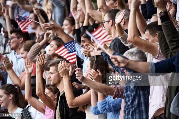 spectators on a stadium with usa playing - democracy stock pictures, royalty-free photos & images