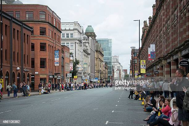spectators on deansgate manchester - manchester england stock pictures, royalty-free photos & images