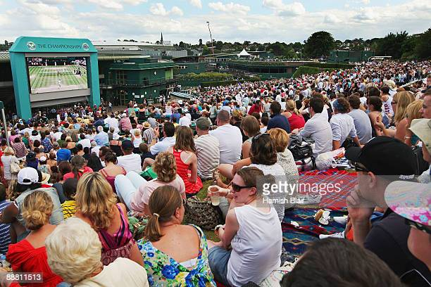 Spectators on 'Murray Mount' watch the Andy Murray of Great Britain v Andy Roddick of USA men's semi final match on big screens on Day Eleven of the...