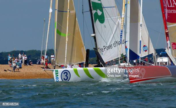 Spectators on the beach at Hurst Spit in Hampshire see some close racing between Mike Golding on Ecover and his French rival Roland Jourdain on Sill...