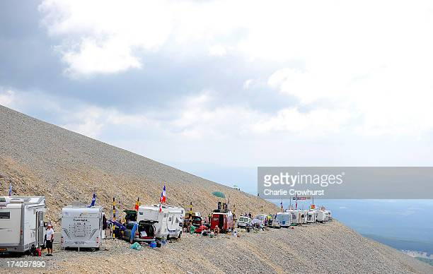 Spectators park their camper vans on the edge of the Mont Ventoux mountain during stage fifteen of the 2013 Tour de France a 2425KM road stage from...