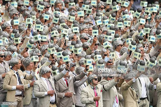 Spectators pay tribute to the late Richie Benaud during day two of the third Test match between Australia and the West Indies at Sydney Cricket...