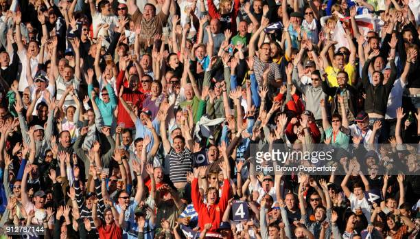 Spectators perform a Mexican wave during the 7th NatWest Series One Day International between England and Australia at the Riverside Ground,...