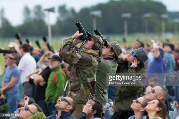 Spectators photograph planes during the International Air Tattoo at RAF Fairford on July 21 2019 in Fairford England The Royal International Air...