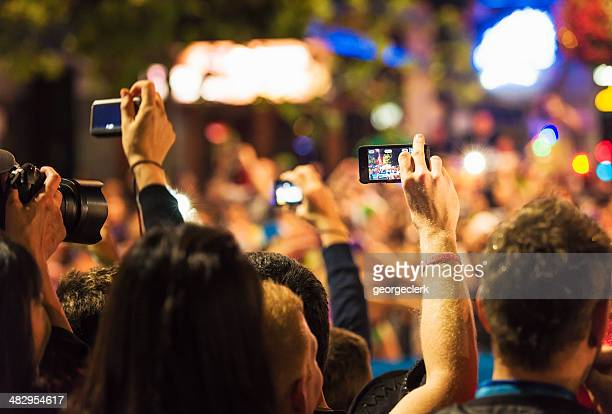spectators photographing an event - mardi gras photos stock pictures, royalty-free photos & images