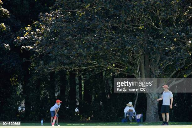 Spectators play backyard cricket during the ICC U19 Cricket World Cup match between South Africa and Kenya at Lincoln Green on January 14 2018 in...