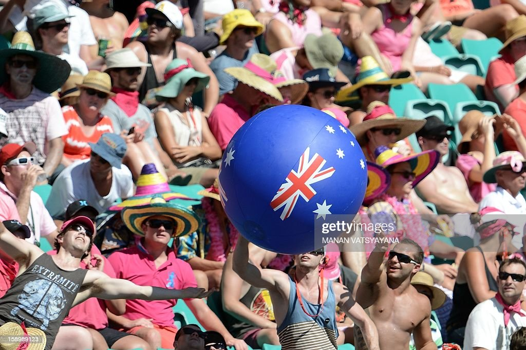 Spectators play with a balloon as they watch day three of the third cricket Test match between Australia and Sri Lanka at the Sydney Cricket Ground on January 5, 2013.