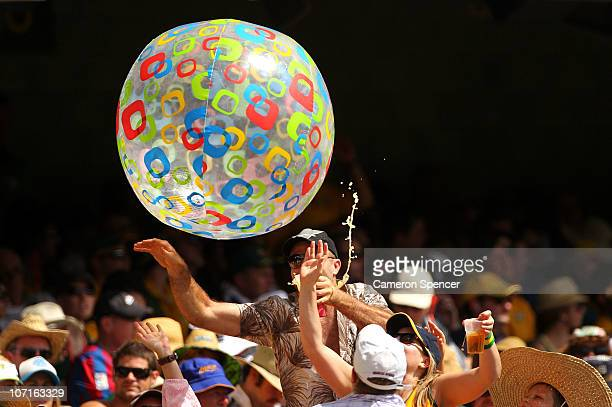 Spectators punch a beach ball into the air during day three of the First Ashes Test match between Australia and England at The Gabba on November 27...