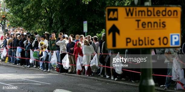 Spectators queue outside on People's Sunday at the Wimbledon Lawn Tennis Championship on June 27 2004 at the All England Lawn Tennis and Croquet Club...