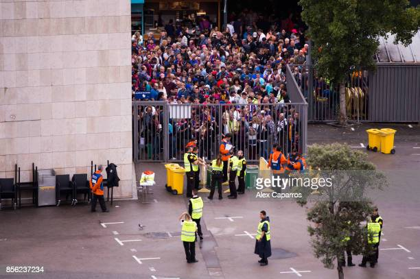 Spectators queue to access the stadium ahead of the La Liga match between Barcelona and Las Palmas at Camp Nou on October 1 2017 in Barcelona Spain...