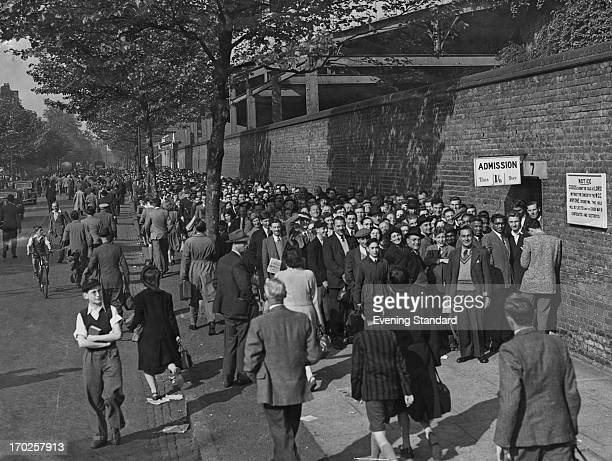 Spectators queuing outside Lord's Cricket Ground London during a County Championship match between Middlesex and Somerset 21st May 1948