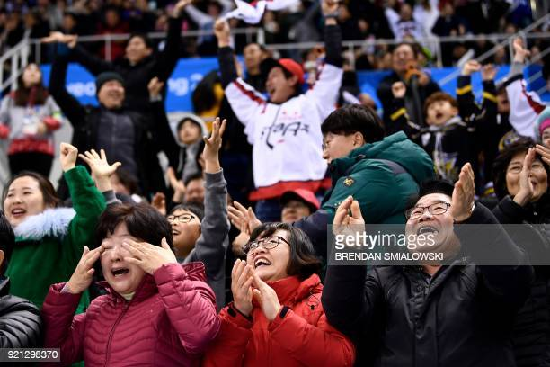 Spectators react after South Korea scored in the men's playoffs qualifications ice hockey match between Finland and South Korea during the...