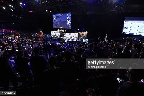 Spectators react after the 'Optic gaming' US team won the Call of Duty Advanced Warfare during the ESWC on May 3 2015 in Paris The video game event...