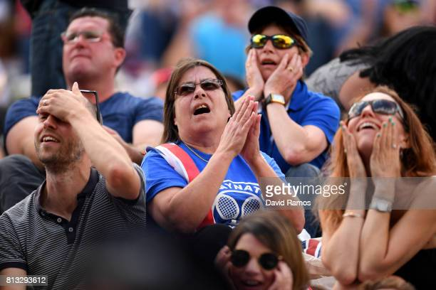 Spectators react as they watch the Gentlemen's Singles quarter final match against between Andy Murray of Great Britain and Sam Querrey of The United...