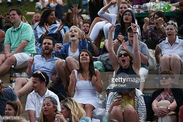 Spectators react at match point as Andy Murray of Great Britain defeated Andreas Seppi of Italy in their Gentlemen's Singles third round match on day...