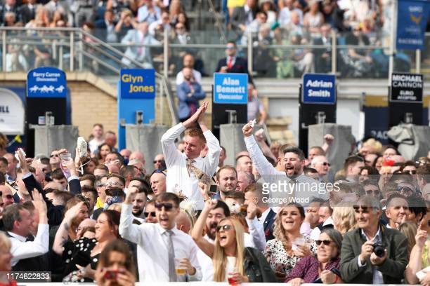 Spectators react during St Leger Day at Doncaster Racecourse on September 14, 2019 in Doncaster, England.