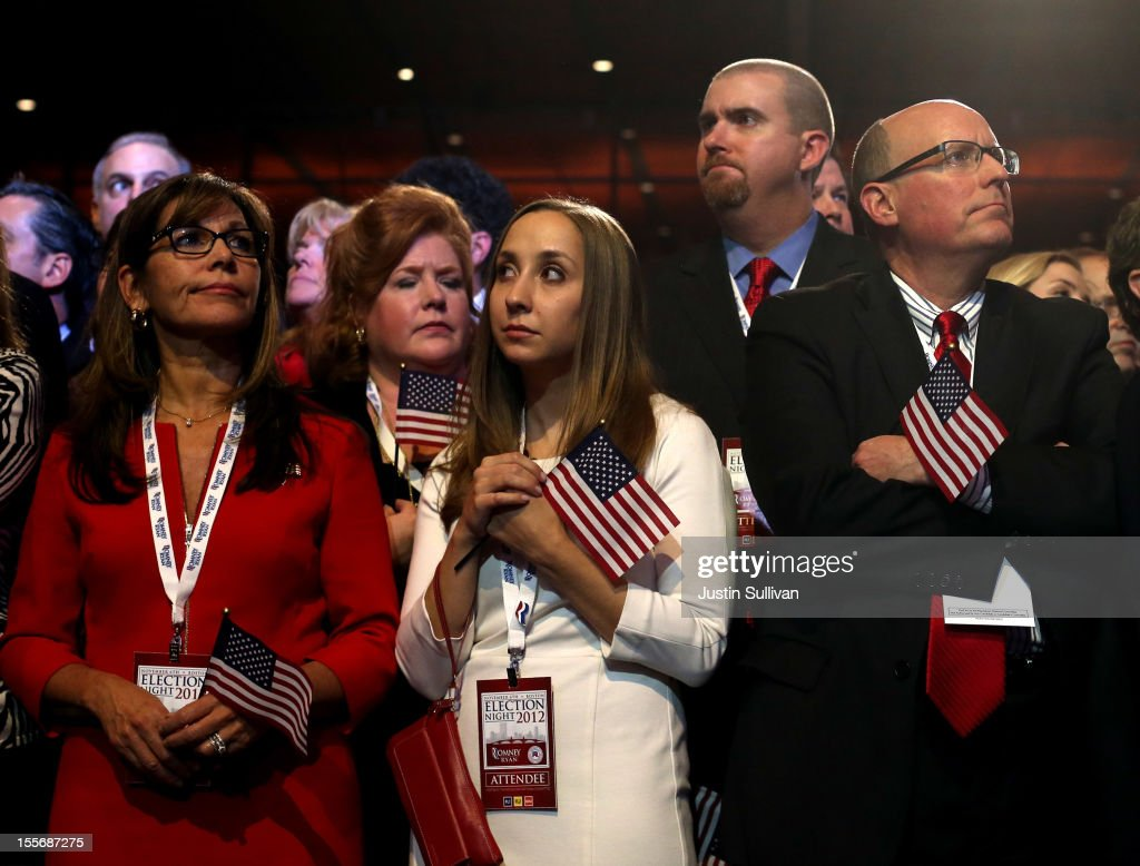 Spectators react to President Obama's projected re-election displayed on large televisions during Mitt Romney's campaign election night event at the Boston Convention & Exhibition Center on November 6, 2012 in Boston, Massachusetts. Voters went to polls in the heavily contested presidential race between incumbent U.S. President Barack Obama and Republican challenger Mitt Romney.