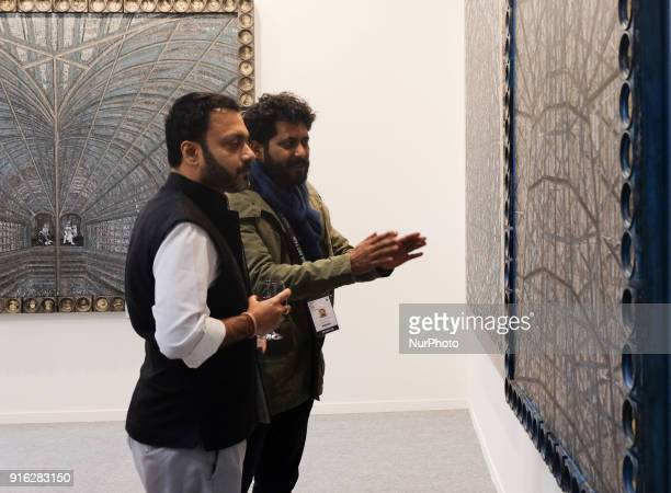Spectators reflect on art installations at the India Art Fair 2018 at the Okhla NSIC grounds in New Delhi on February 9th 2018 The annual fair draws...