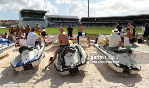 Spectators relax on an artificial beach during the first Test match between England and the West Indies at Kensington Oval on January 23 2019 in...
