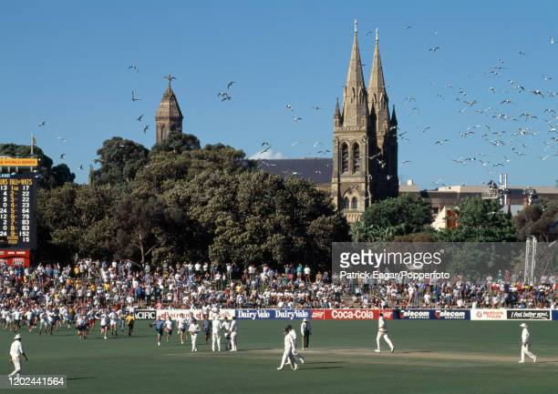 Spectators run onto the field after the last Australian wicket falls Peter McIntyre LBW for 0 and England win the 4th Test match between Australia...