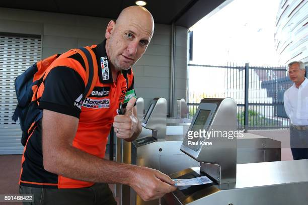 Spectators scan their ticket for entry during the Twenty20 match between the Perth Scorchers and England Lions at Optus Stadium on December 13 2017...