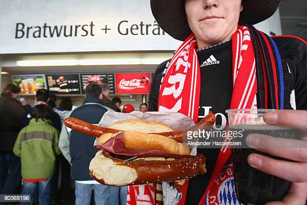 Spectators seen at a food store during the Bundesliga match between Bayern Munich and Bayer Leverkusen at the Allianz Arena on March 22 2008 in...