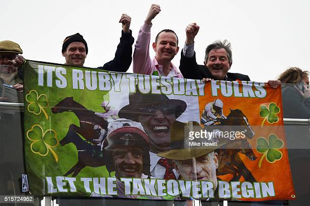 Spectators show their support for jockey Ruby Walsh on day one Champion Day of the Cheltenham Festival at Cheltenham Racecourse on March 15 2016 in...