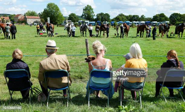 Spectators sit at the ringside watching events during 152nd the Ryedale Country Show on July 31 2018 in Kirbymoorside England Held in Welburn Park...