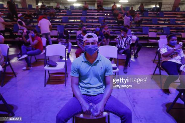 Spectators sit in the bleachers wearing masks and taking distance at Alexis Arguello Sports Center on April 25 2020 in Managua Nicaragua Nicaragua is...