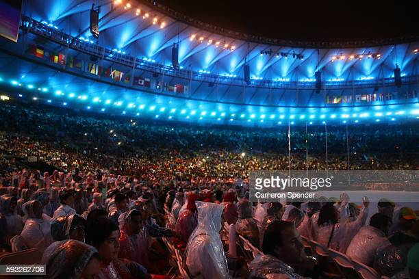 Spectators sit in the rain during the Closing Ceremony on Day 16 of the Rio 2016 Olympic Games at Maracana Stadium on August 21 2016 in Rio de...